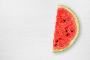 Watermelon slice on white table