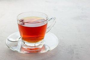 Healthy herbal rooibos red tea in glass cup, copy space