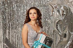 Girl and Christmas gift.