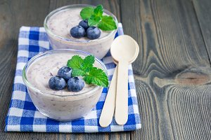 Cream cheese and blueberry mousse in glass, horizontal, copy space