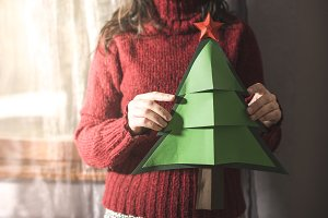 Woman hold fir christmas tree