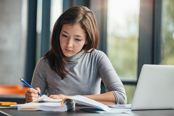 Education Stock Photos: Jacob Lund - Woman taking down notes in diary