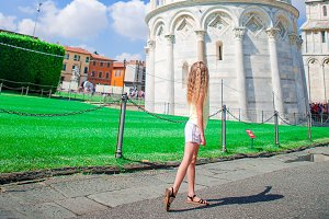 Little girl on italian vacation near the famous Leaning Tower of Pisa