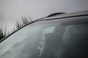 Woman in car thinking