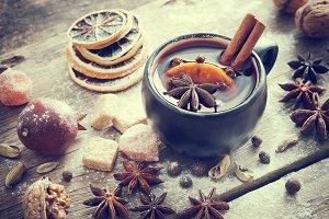 Mulled wine in mug and ingredients