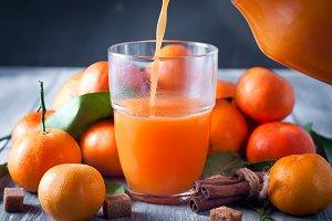 Healthy mandarin juice on wooden table