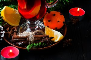 Mulled wine, tree branch and spices