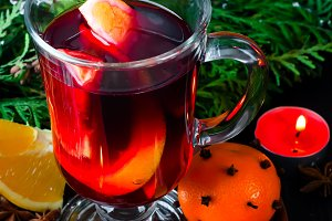 Mulled wine for Christmas Eve celebration party by  tree.