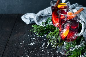 Christmas mulled wine with spices in glass,