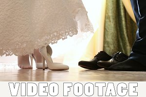 Bride and groom wear wedding shoes