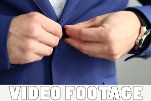 Man fasten the button on his jacket