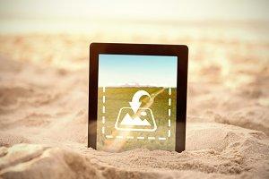 Digital tablet kept on sand