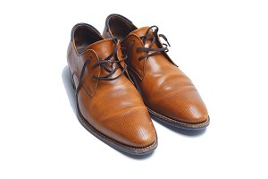 In brown leather shoes