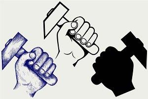 Hand holding hammer SVG