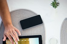 Woman hand touching digital tablet