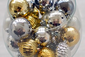 Christmas tree decorations in a glass vase