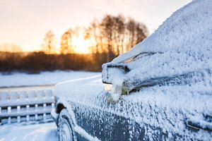 The snow-covered car