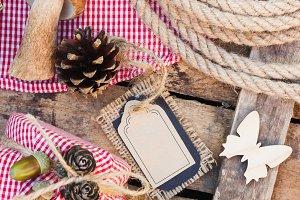 Raw white mushrooms, pine cones and decorative tag