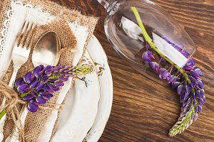 Tableware with violet lupines and silverware