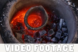 The hot crucible is in the furnace
