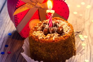 Birthday cake with candle and  gift