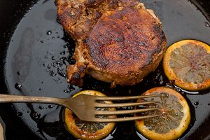 pork chop roasted on iron skillet