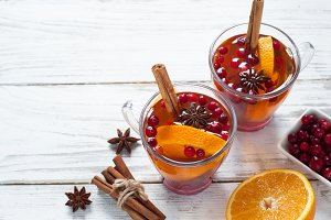 Cup of hot tea with fruit and spices.