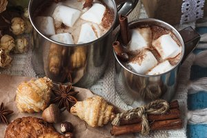 Metal mugs with cacao and marshmallows