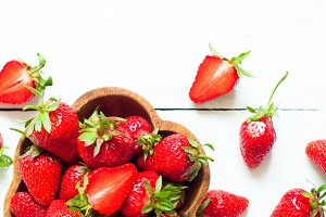 Fresh strawberries in woden bowl