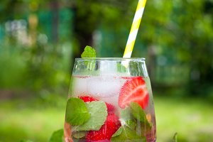 Summer drink with mint, strawberry, lemon