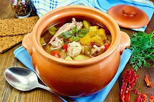 Roast meat and vegetables in pot