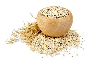 Oat flakes and stalks isolated