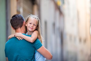 Family in Europe. Happy father and little adorable girl in old city during summer italian vacation