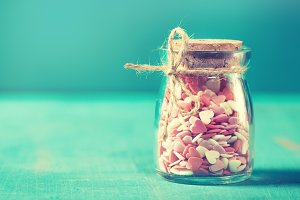 Love concept with hearts in jar