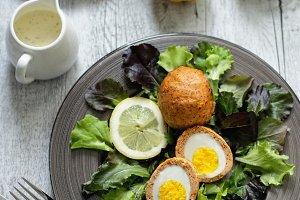 Scotch eggs on dark beautiful plate