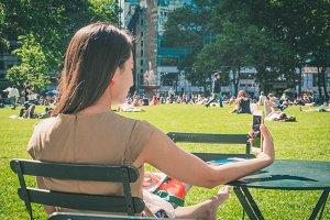 Woman make selfie at Bryant Park