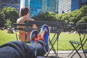 Man relaxing at Bryant Park, NY