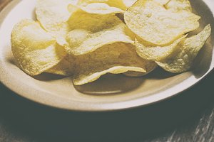 A plate with chips on a table