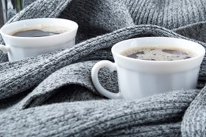 Two white cups of coffee
