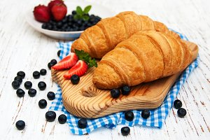Fresh berries and croissant