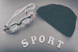 Goggles, hat and sport letters