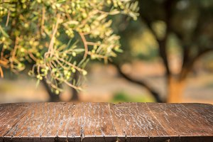 Olives with old wooden table.