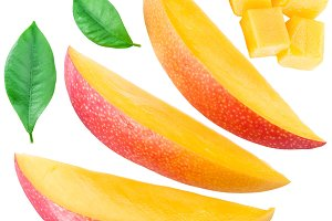 Slices of mango fruit and leaves
