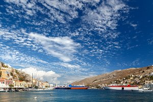 Bay of Symi, with ships and rich blue sky  clouds