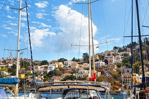 view from pier on the island of Symi in the house and sailing yachts