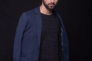 man posing smart casual, suit, jeans