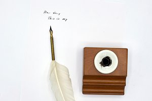 Feather Pen on a letter