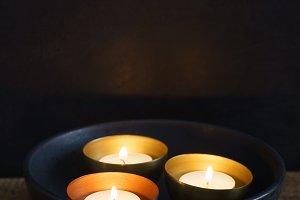 Three votive candles