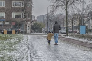 Man with child in winter