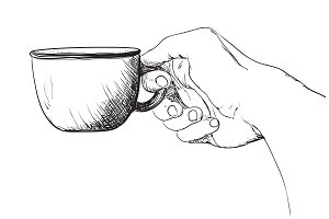 Hot tea or coffee in the hand